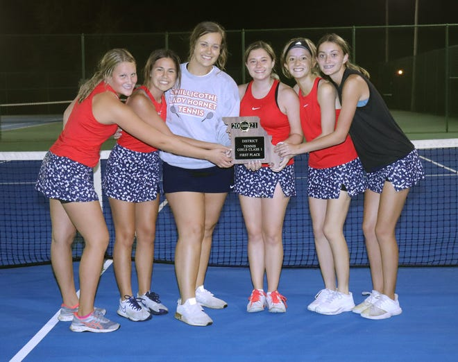 2021 Chillicothe High School tennis Lady Hornets team members (from left) Rylee Washburn, Cami Carpenter, Olivia Anderson, Haley Snider, Leah Lourenco and Izzy Garr display their Class 1 District 15 team tournament championship plaque after winning it over host Trenton 5-4 Wednesday evening in a match which lasted nearly six hours.