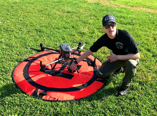 Delaware police officer Jordan Cornwell describes features of the department's DJI Matrice 300 RTK, a radio-controlled unmanned aerial vehicle, during a practice flight Oct. 5 on city-owned land off Curve Road. Delaware is among a number of central Ohio police agencies using drones equipped with sophisticated cameras.