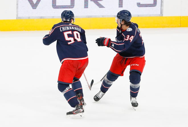 Blue Jackets center Cole Sillinger (34) skates around right wing Yegor Chinakhov (59) during Wednesday's win over the Red Wings. Both players are potential building blocks for the franchise.