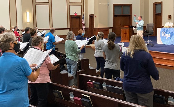 Director Josh Brodbeck rehearses with the Delaware Community Chorus on Oct. 4 at Powell United Methodist Church.