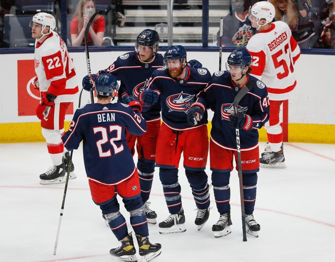 Teammates celebrate a goal by Columbus Blue Jackets right wing Jakub Voracek (93) during the third period of the NHL preseason hockey game against the Detroit Red Wings at Nationwide Arena in Columbus on Wednesday, Oct. 6, 2021. The Blue Jackets won 4-2.