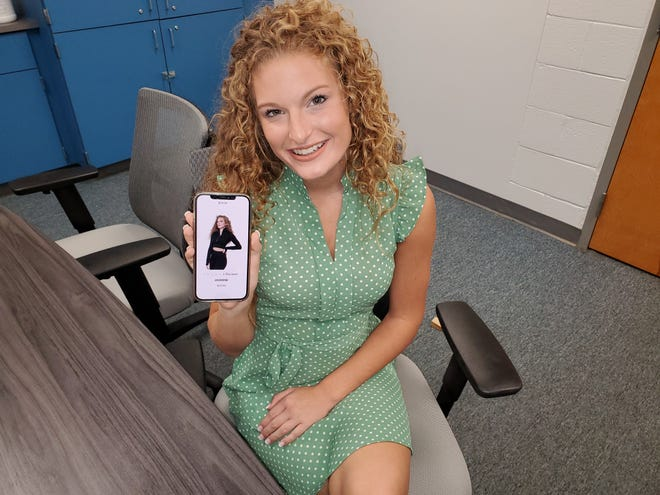 Randolph County teenager Josie Perdue shows a photo of herself on designer Marc Defang's website modeling activewear. The 17-year-old recently traveled to the Big Apple to walk in the designer's show during New York Fashion Week. Here, she sits in a conference room at her former school Tabernacle Elementary, where her mother is a teacher.
