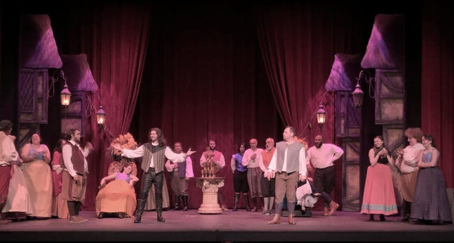 """William Shakespeare, played by Patrick Wallace, struts for his adoring fans while an envious Nick Bottom, played by Steve DeBruyn, looks on in a scene from """"Something Rotten"""" at the Croswell Opera House."""