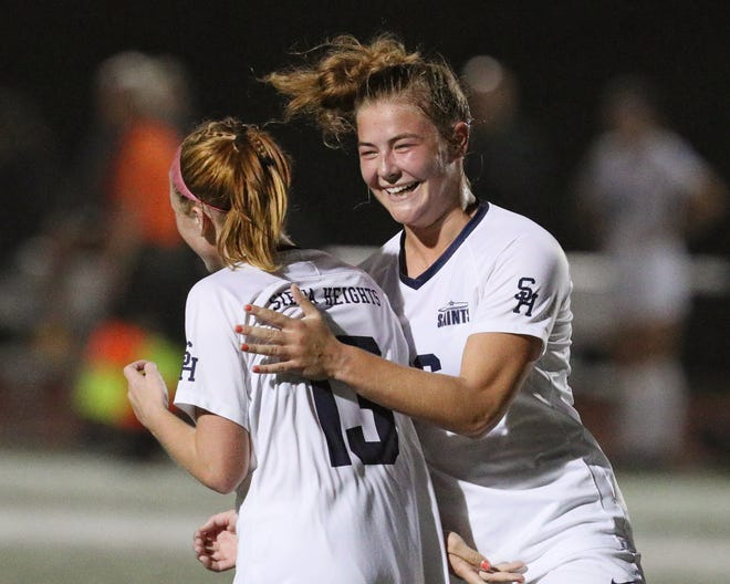 Siena Heights' Sarah Ammon (left) celebrates her second goal of the game with Kennedy Hyde, who assisted on the goal. [Telegram photo by John Discher]