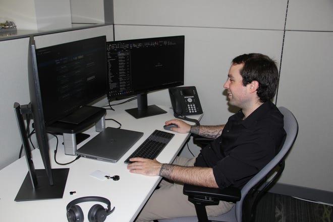 Apprentice Michael Roue on the job training.