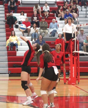 Coldwater's Jayla Foster tips the ball back over her head as teammates Jaleah Sloan (8) and Elly Foley (6) look on versus Parma Western on Wednesday