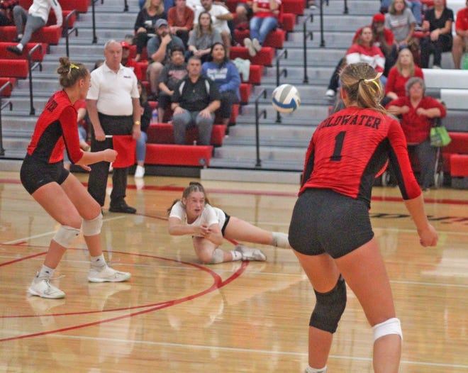 Coldwater libero Violet Waltke gets to another near impossible dig Tuesday night while teammates look on.