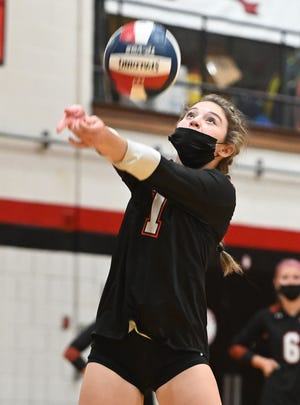 Oliver Ames' Rachel Fleischman sets the ball during the Tigers' 3-0 win over Brockton on Oct. 6.