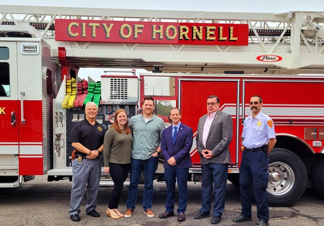 Pictured from left to right are Public Safety Commissioner Scott Richardson, Christina Quinlan, Firefighter Shaymis Quinlan, Mayor John Buckley, Commissioner David Parmley, and Fire Chief Frank Brzozowski.