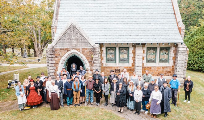 Summersworth Historical Society members and volunteers stand outside historic Furber Chapel which is located in Forest Glade Cemetery.
