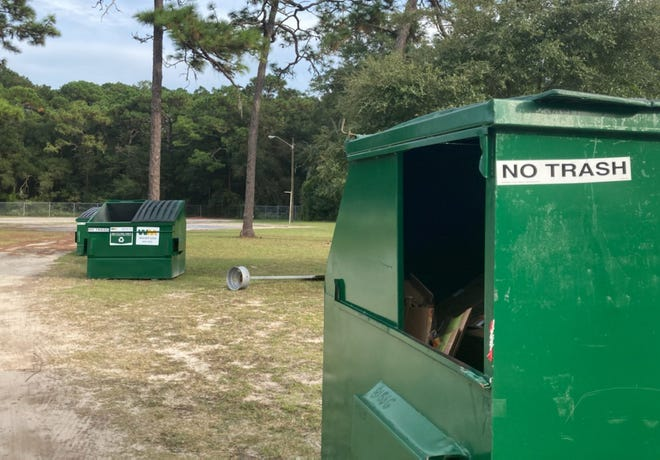 Dumpsters are lined up at Southside Estates Elementary Park, 9764 Jupiter Court South, one of 14 drop-off sites set up across Jacksonville to receive recyclables.