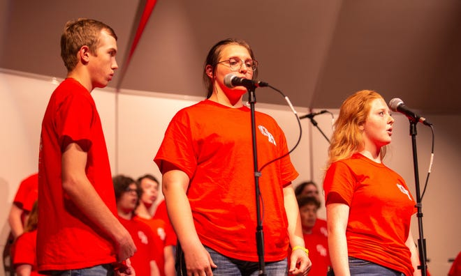 """Weston Henry, BrookLynn Peterson and Hannah McCarthy perform their solos in the Glen Rose Varsity Choir rendition of """"This is the Day"""" at the Fall Concert on Monday night at the GRHS Auditorium."""