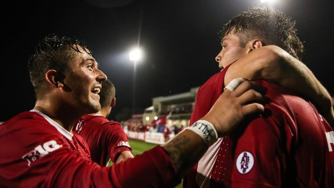 Indiana's Victor Bezerra, right, celebrates with his teammates after scoring the game-winning goal with 21 seconds left in overtime on Wednesday night against Omaha at Armstrong Stadium.