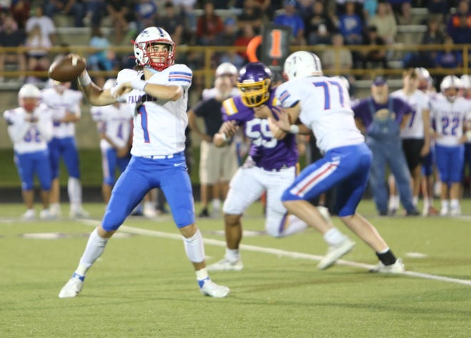 West Henderson quarterback Lukas Kachilo fires downfield during a game earlier this season against North Henderson.