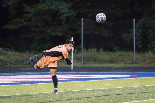 North Henderson keeper Edgar Soto throws the ball to teammates in the first half of action against West Henderson on Wednesday at West.