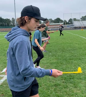 Airport High School freshman Jacob Trythall balances a plastic egg during one of the games played Wednesday during Homecoming week.