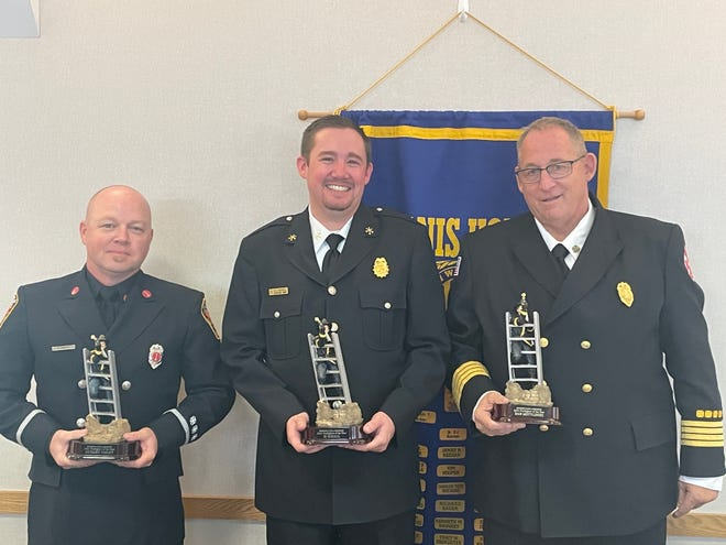 Lt. Scott Smiley of the Monroe Fire Department; Assistant Fire Chief R.J. Schall of the Summerfield Township Volunteer Fire Department and Chief Dan Motylinski of the Dundee Township VFD pose with their Firefighter of the Year awards during the Kiwanis Club of Downtown Monroe luncheon.
