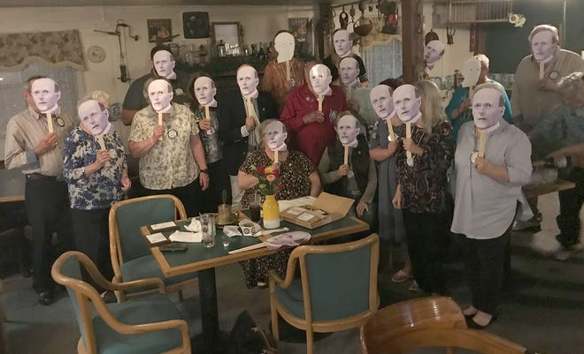 Members of the Oriskany Falls Rotary Club don masks of Rotary International founder Paul Harris Oct. 6 during their meeting at the Hotels Solsville. Each member of the club was commemorated that evening as a Paul Harris Fellow, a recognition that acknowledges Rotarians who have contributed - or had contributions made in their name - of $1,000 to The Rotary Foundation.