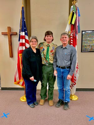 Koby Lane Loveless, who has earned the rank of Eagle Scout, is pictured with his parents, Debra and Kenneth.