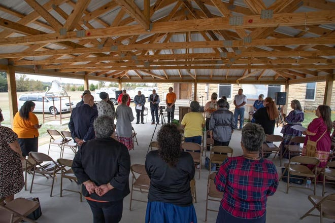 People participate in the Oklahoma Indian Missionary Conference of the United Methodist Church's remembrance service for children who experienced the Native American boarding school era. The event was held in the open-air tabernacle at Thlopthlocco United Methodist Church near Okemah.