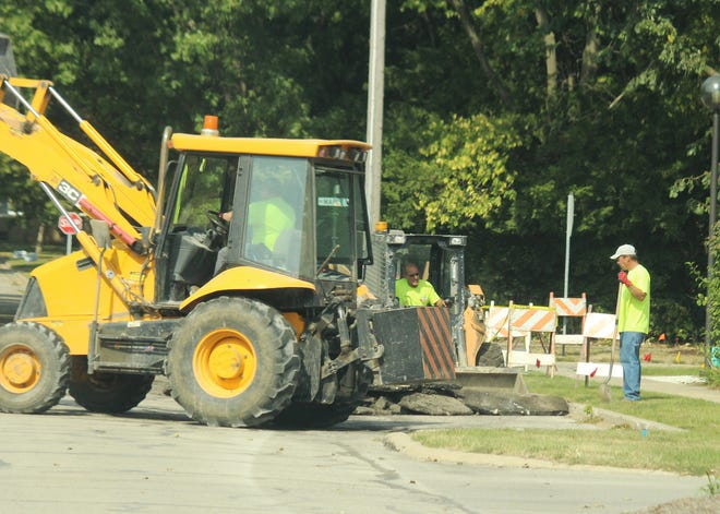 City workers deal with the sink hole issue at the intersection of Maple and Third streets recently. Sewer Superintendent Brad Duncan reported to the city council that work was close to being done.