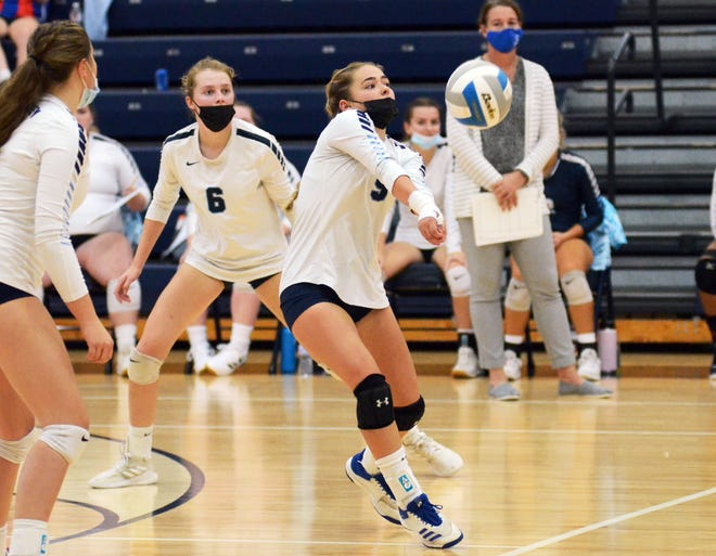 Petoskey's Lucy Tarachas (front) makes a pass off a serve during the second set against Traverse City Central Wednesday in the Petoskey High School gym.