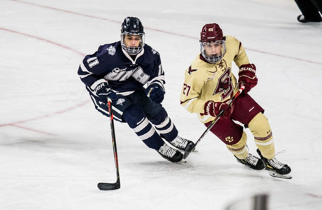 Jackson Pierson, left, led the University of New Hampshire men's hockey team in goals (nine), assists (16) and points (25) last season.