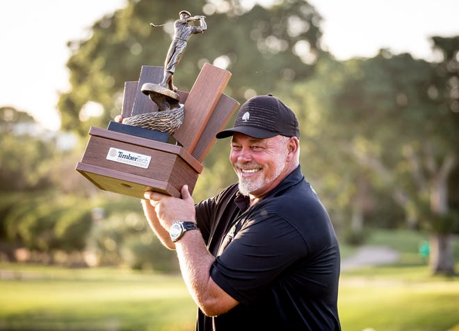 Darren Clarke celebrates winning last year's TimberTech Championship at The Old Course in Boca Raton.