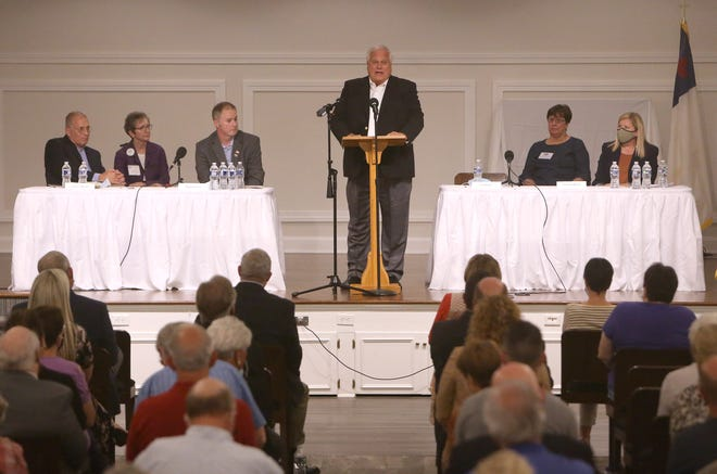 Jon Snyder, candidate for council at large, speaks during the Canton Area League of Women Voters forum. Other Candidates seated are (from left) Daryl L. Revoldt, Matthew Stroia and Christina Weyrick.
