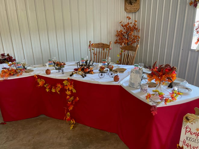 """The bridal party table referred to as the """"Eck"""" was beautifully decorated in a fall theme."""
