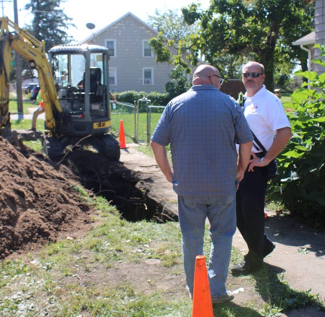 LaPorte Fire Chief Andy Snyder (right) and LaPorte Code Enforcement Director Jeff Batchelor discuss the rescue of a man who is now recovering after being buried in a trench collapse on Park Street.