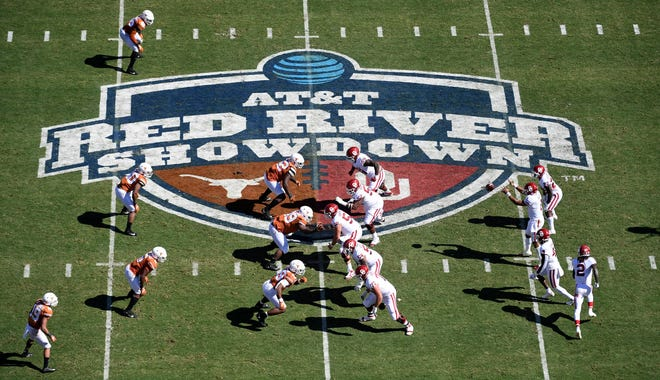 In this Oct. 12, 2019, file photo, Oklahoma, right, runs a play against Texas in the first half of an NCAA college football game at the Cotton Bowl in Dallas. The Big 12 will have nothing like the Red River rivalry on the second Saturday in October once Texas and Oklahoma make their move to the Southeastern Conference.