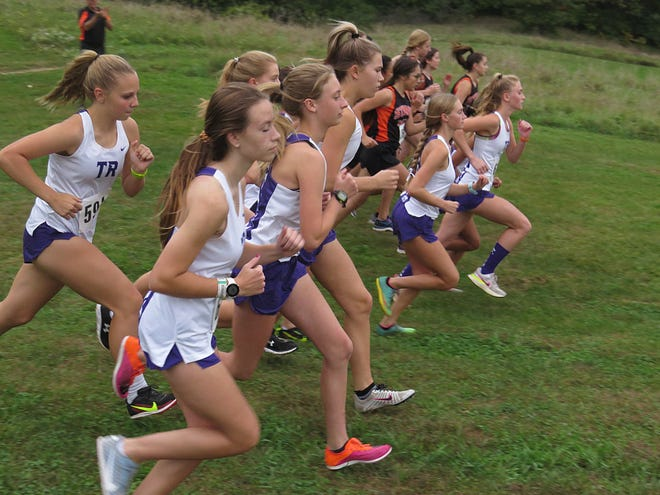 The Sturgis and Three Rivers cross country teams take off from the starting line on Wednesday evening.