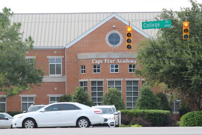 Three former Cape Fear Academy students have filed a lawsuit against the school.