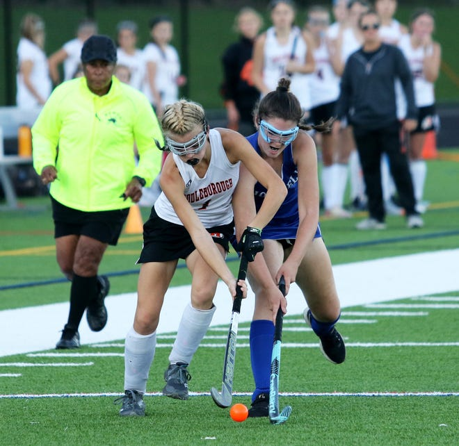 Middleboro's Patience Beasley battles for possession of the ball during a South Shore League field hockey matchup with Norwell on Wednesday, Oct. 6. The game ended in a scoreless tie. The two teams played to a scoreless tie in the first meeting of the season back in September at Norwell High School.
