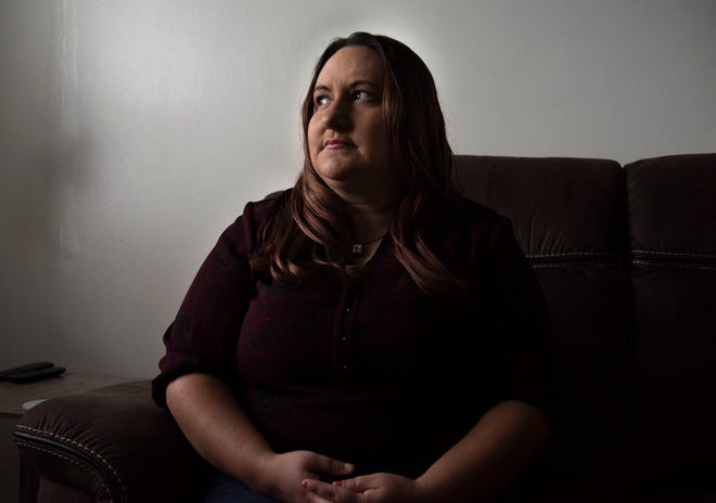 Heather McComas Harrison, a survivor of marital rape, poses in her home in Grove City, Ohio, on Thursday, Oct. 7, 2021. Harrison was a victim of marital rape, and in some certain instances, it is technically protected under Ohio law. A bill was introduced to change this, but the law still has not changed.