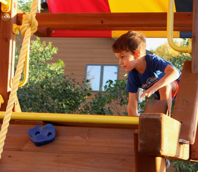 Cody Carey of Mellette, 3, got his first look at the Rainbow playset in his backyard Wednesday evening during an unveiling celebration from Make-A-Wish of South Dakota and Montana.