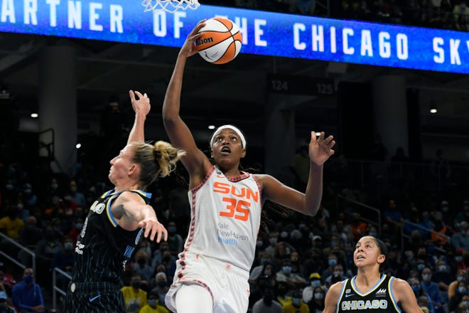 Connecticut Sun's Jonquel Jones (35) goes up for a shot against Chicago Sky's Courtney Vandersloot (22) and Candice Parker right, during the Sun's 79-69 loss in Game 4 of the WNBA playoff semifinals Wednesday in Chicago.