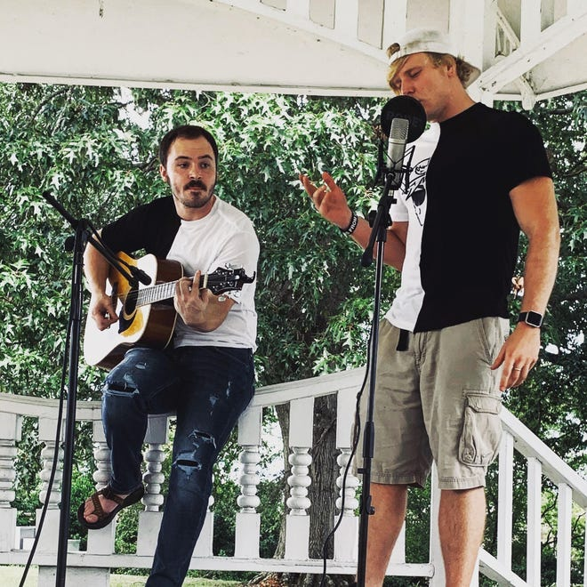 Local band 50 Fifty, made up of Etowah High graduates Daniel Fulmer, left, and Kylan Smith, will host a Halloween concert/party at 210 At The Tracks in Gadsden on Oct. 29.