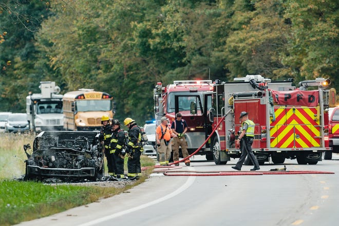 Firefighters from the New Philadelphia Fire Department attend to the remains of a pickup truck fire on state Route 39 near Beaver Dam Road in Goshen Township on Wednesday afternoon. Law enforcement on scene and the truck's owner reported a small amount of ammunition to be in the vehicle at the time of the fire. Route 39 was closed in both directions during the incident.