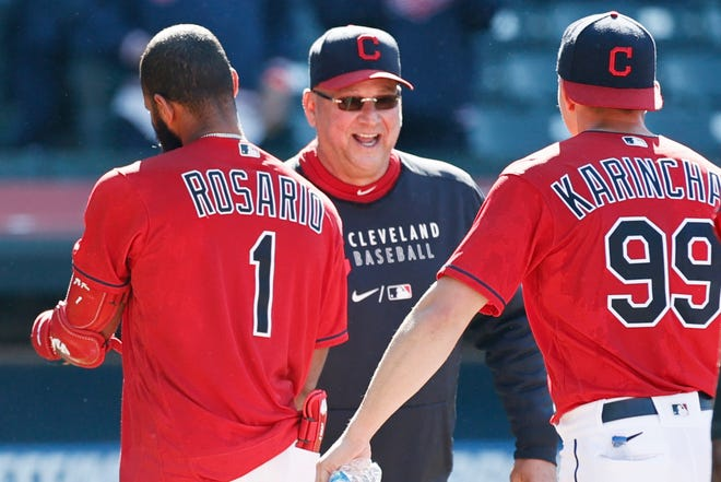 FILE - In this Wednesday, May 12, 2021 file photo, Cleveland Indians manager Terry Francona, center, celebrates with Amed Rosario (1) and James Karinchak (99) after defeating the Chicago Cubs 2-1 in 10 innings of a baseball game in Cleveland. Indians manager Terry Francona is confident he'll return next season after missing most of the past two because of serious health issues. Francona was forced to step away from the club in late July to undergo surgeries on his hip and big toe.