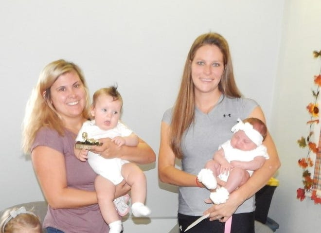 First-place winner in the Baby Contest Division 0-6 Girls was Eloise Starks, left, held by Avaly Starks. Second-place winner was Adalynn Turner, held by Brooks Mundy.