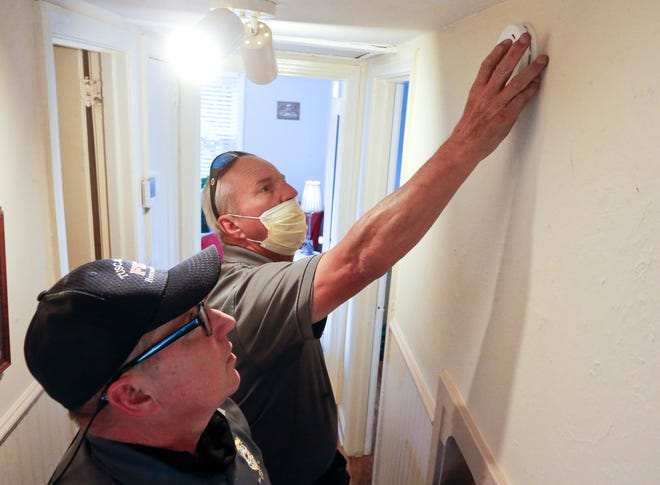 Tuscaloosa firefighters check and install smoke alarms for residents in the Circlewood area of the city Thursday, Oct. 7, 2021. Frankie Malone and Johnny Fulmer install a new smoke alarm for a resident on Circlewood Drive. [Staff Photo/Gary Cosby Jr.]