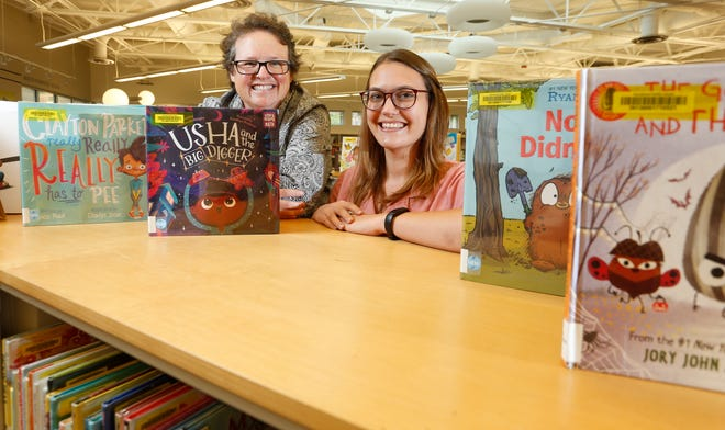 Weaver Bolden Branch librarians Marti Ball, left, and Sadie Zabawa are the moving force behind the Tuscaloosa StoryWalk which has its home in Alberta's Jaycee Park. [Staff Photo/Gary Cosby Jr.]