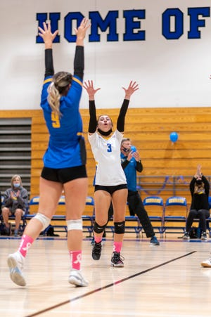 Serrano players celebrate during a volleyball match against Apple Valley at the high school in Phelan, CA, on Oct. 6, 2021.
