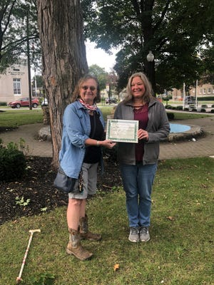Sue Brey, right, accepts the Newark Garden Club's Civic Beautification Award on behalf of Bodine's Southend Market. The annual award recognizes businesses and organizations that create an outstanding horticultural display. Pictured with Brey is club member Julia Young.