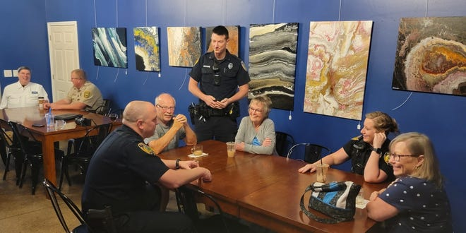 Officers Steve Rehorst, left, Jeremy Bjerke and Amy Beyl indulge in beverages and conversations with Watertown citizens Everett and Mary Johnson and Margaret Schneider Wednesday at Gather.