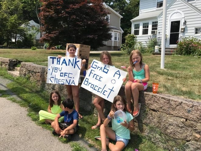 Ronan Manke, (bottom row) and his friends urge people to obtain a blue and white bracelet to wear in support of fallen Weymouth Police Sgt. Michael C. Chesna in July 2018. [Courtesy Photo]