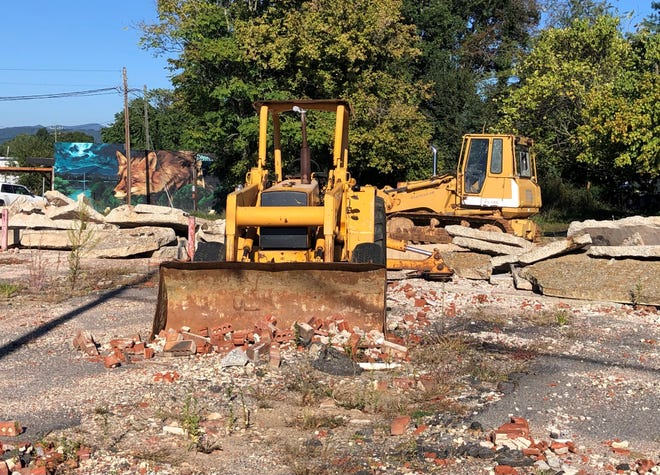 A pile of rubble and concrete debris has been sitting at a site on Haywood Road in West Asheville since early in 2021. The city issued a stop work order on the demolition because of the potential of an old cemetery being there.