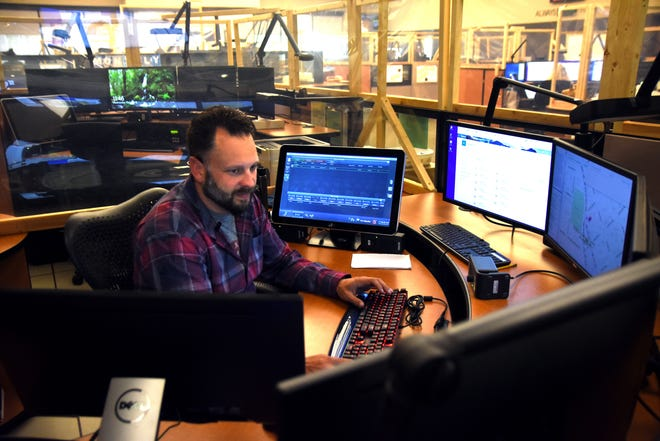 Tim Robrahn, a dispatcher, takes calls from people who dial 911 in Kitsap County at Kitsap 911 on Oct. 6. Voters will decide in the Nov. 2 election if a 0.1% sales tax should be implemented to fund the purchase of new facilities and equipment for the dispatch center.